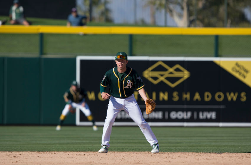 MESA, AZ - MARCH 1: Nick Allen of the Oakland Athletics fields during the game against the Texas Rangers at Hohokam Stadium on March 1, 2018 in Mesa, Arizona. (Photo by Michael Zagaris/Oakland Athletics/Getty Images) *** Local Caption *** Nick Allen