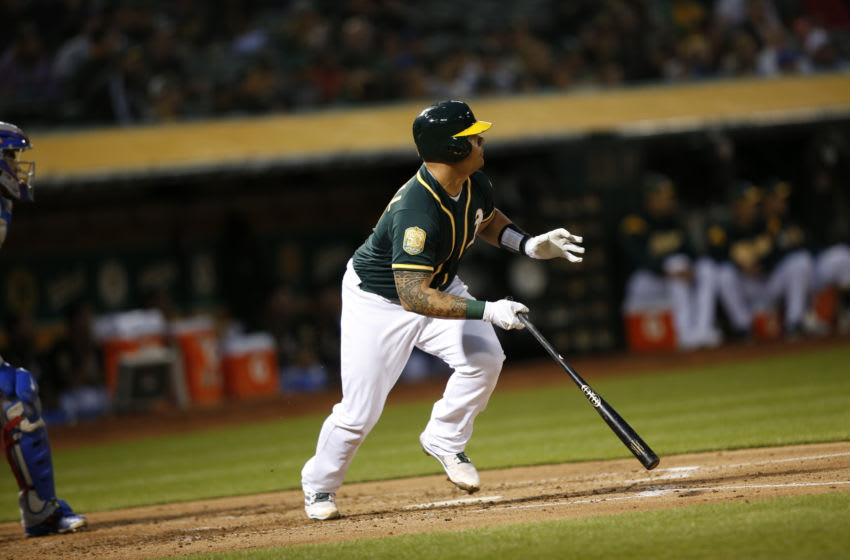 OAKLAND, CA - APRIL 4: Bruce Maxwell #13 of the Oakland Athletics bats during the game against the Texas Rangers at the Oakland Alameda Coliseum on April 4, 2018 in Oakland, California. The Athletics defeated the Rangers 6-2. (Photo by Michael Zagaris/Oakland Athletics/Getty Images) *** Local Caption *** Bruce Maxwell