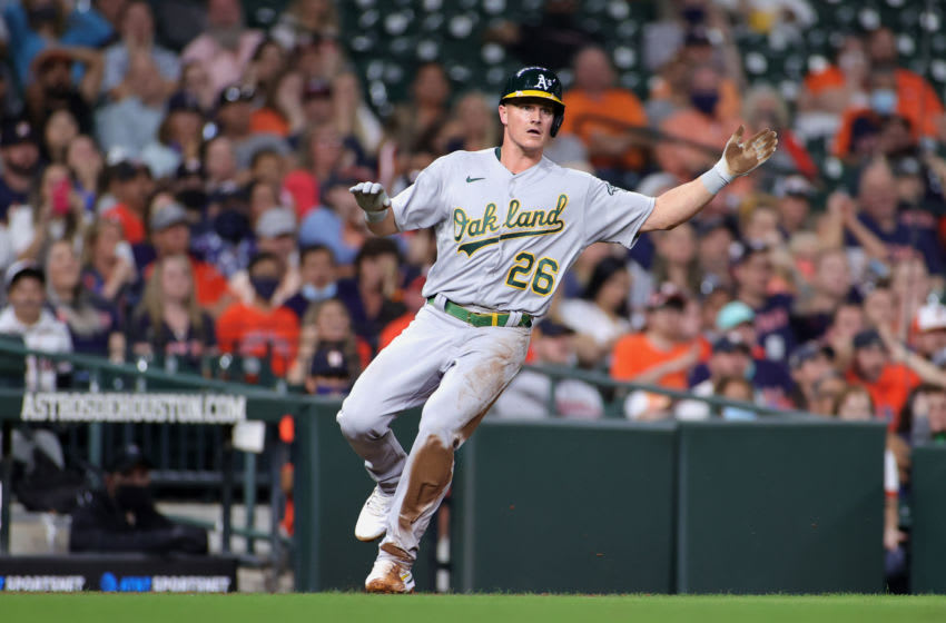 HOUSTON, TEXAS - APRIL 09: Matt Chapman #26 of the Oakland Athletics rounds third base during the fourth inning against the Houston Astros at Minute Maid Park on April 09, 2021 in Houston, Texas. (Photo by Carmen Mandato/Getty Images)