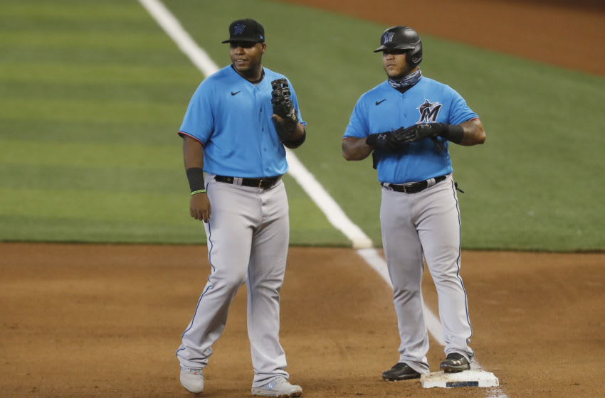 MIAMI, FLORIDA - JULY 12: Jesus Aguilar #24 and Harold Ramirez #47 of the Miami Marlins look on during a simulated game at Marlins Park on July 12, 2020 in Miami, Florida. (Photo by Michael Reaves/Getty Images)
