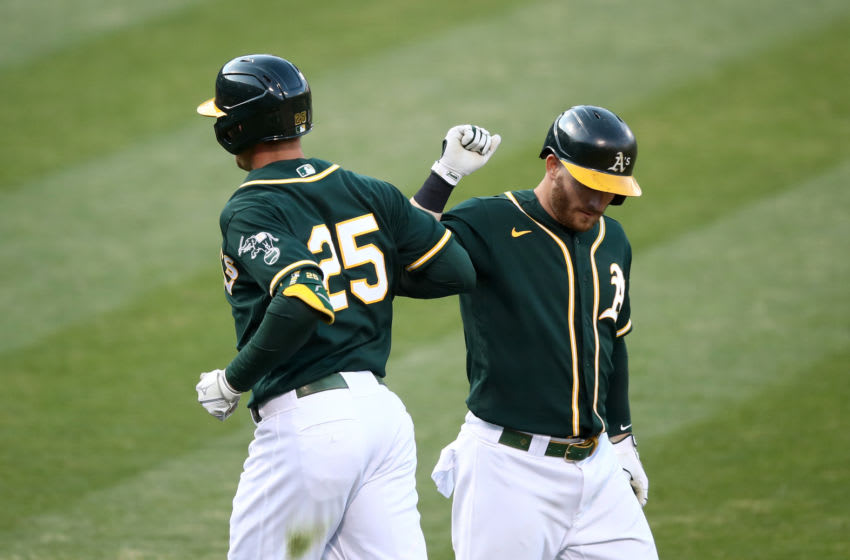 OAKLAND, CALIFORNIA - JULY 20: Stephen Piscotty #25 of the Oakland Athletics is congratulated by Robbie Grossman #8 after he hit a home run in the second inning against the San Francisco Giants during their exhibition game at Oakland-Alameda County Coliseum on July 20, 2020 in Oakland, California. (Photo by Ezra Shaw/Getty Images)