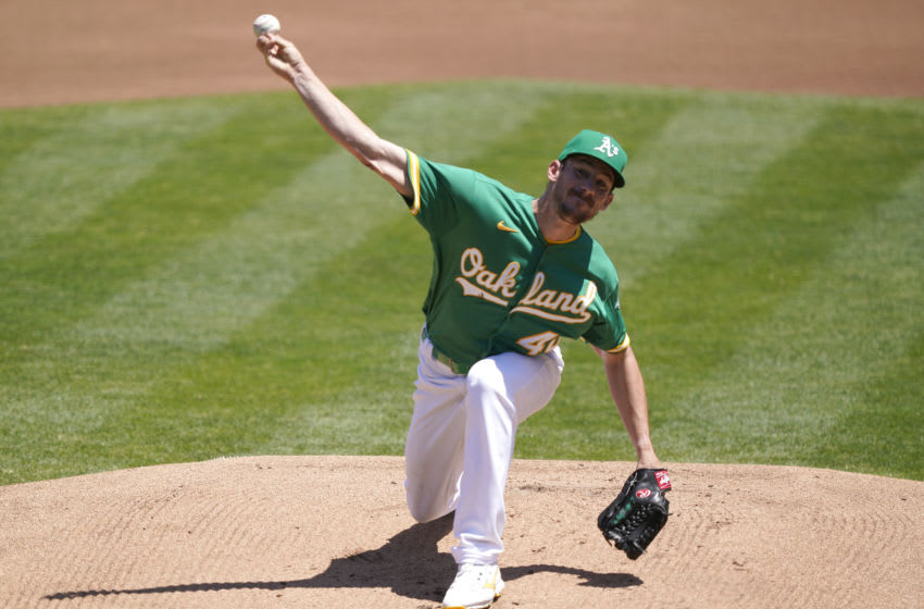 OAKLAND, CALIFORNIA - JULY 27: Chris Bassitt #40 of the Oakland Athletics pitches against the Los Angeles Angels in the top of the first inning at RingCentral Coliseum on July 27, 2020 in Oakland, California. (Photo by Thearon W. Henderson/Getty Images)