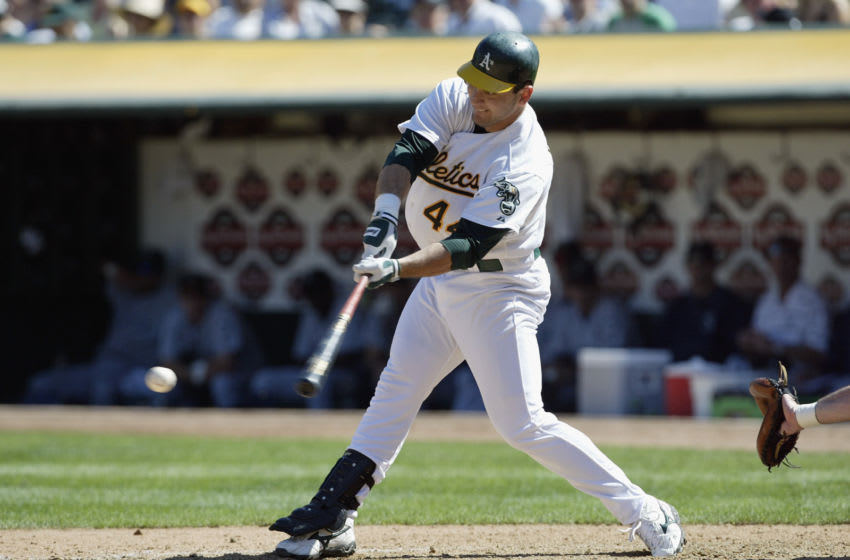 OAKLAND, CA - SEPTEMBER 20: First baseman Erubiel Durazo #44 of the Oakland A's swings at the pitch against the Seattle Mariners during the game at the Network Associates Coliseum on September 20, 2003 in Oakland, California. The Mariners defeated the A's 9-3. (Photo by Jed Jacobsohn/Getty Images)