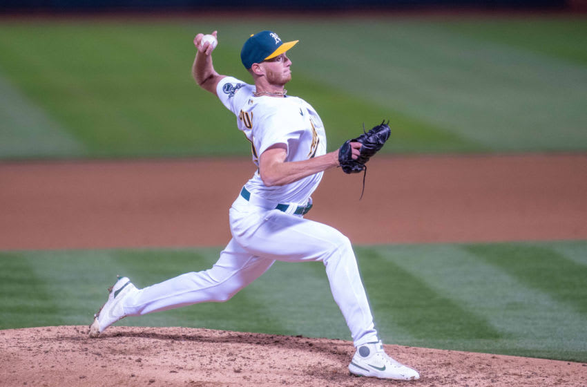 Apr 5, 2021; Oakland, California, USA; Oakland Athletics pitcher A.J. Puk (33) delivers a pitch against the Los Angeles Dodgers during the fourth inning at RingCentral Coliseum. Mandatory Credit: Neville E. Guard-USA TODAY Sports