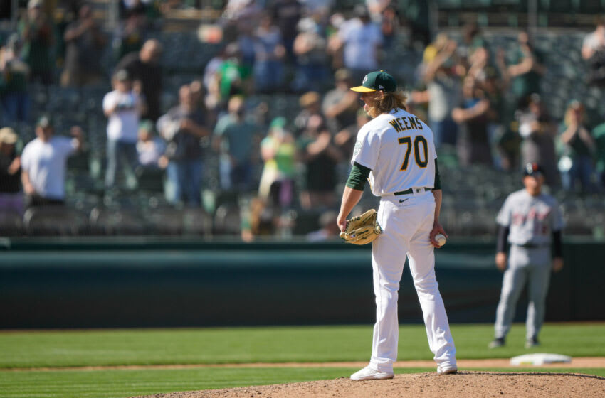 Apr 17, 2021; Oakland, California, USA; Crowd cheers as Oakland Athletics relief pitcher Jordan Weems (70) readies himself to pitch during the ninth inning against the Detroit Tigers at RingCentral Coliseum. Mandatory Credit: Stan Szeto-USA TODAY Sports