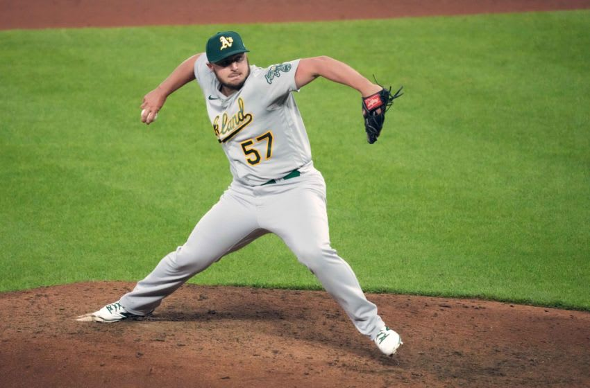 Apr 23, 2021; Baltimore, Maryland, USA; Oakland Athletics pitcher J.B. Wendelken (57) pitches during the eighth inning against the Baltimore Orioles at Oriole Park at Camden Yards. Mandatory Credit: Mitch Stringer-USA TODAY Sports