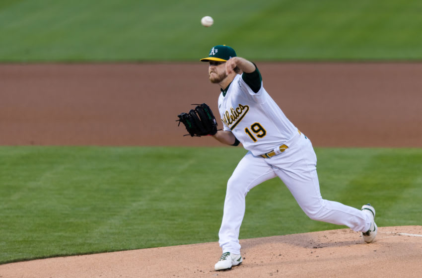 May 4, 2021; Oakland, California, USA; Oakland Athletics starting pitcher Cole Irvin (19) throws against the Toronto Blue Jays in the first inning at RingCentral Coliseum. Mandatory Credit: John Hefti-USA TODAY Sports