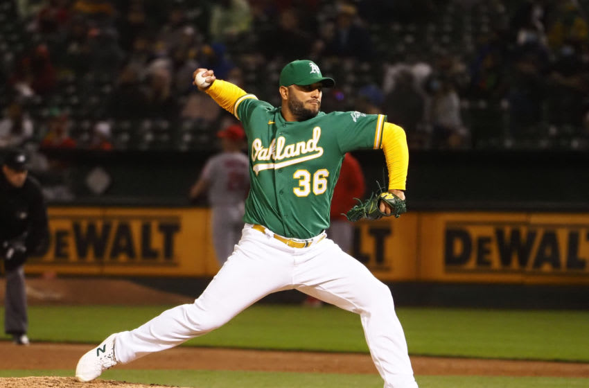 May 28, 2021; Oakland, California, USA; Oakland Athletics relief pitcher Yusmeiro Petit (36) pitches against the Los Angeles Angels during the eighth inning at RingCentral Coliseum. Mandatory Credit: Kelley L Cox-USA TODAY Sports