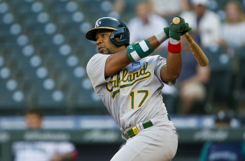 Jun 2, 2021; Seattle, Washington, USA; Oakland Athletics shortstop Elvis Andrus (17) hits a double against the Oakland Athletics during the third inning at T-Mobile Park. Mandatory Credit: Joe Nicholson-USA TODAY Sports