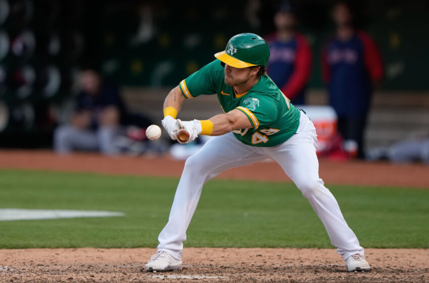 Jul 3, 2021; Oakland, California, USA; Oakland Athletics center fielder Skye Bolt (49) bunts during the ninth inning against the Boston Red Sox at RingCentral Coliseum. Mandatory Credit: Stan Szeto-USA TODAY Sports