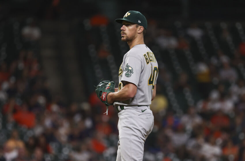 Jul 6, 2021; Houston, Texas, USA; Oakland Athletics starting pitcher Chris Bassitt (40) reacts after a play during the fourth inning against the Houston Astros at Minute Maid Park. Mandatory Credit: Troy Taormina-USA TODAY Sports