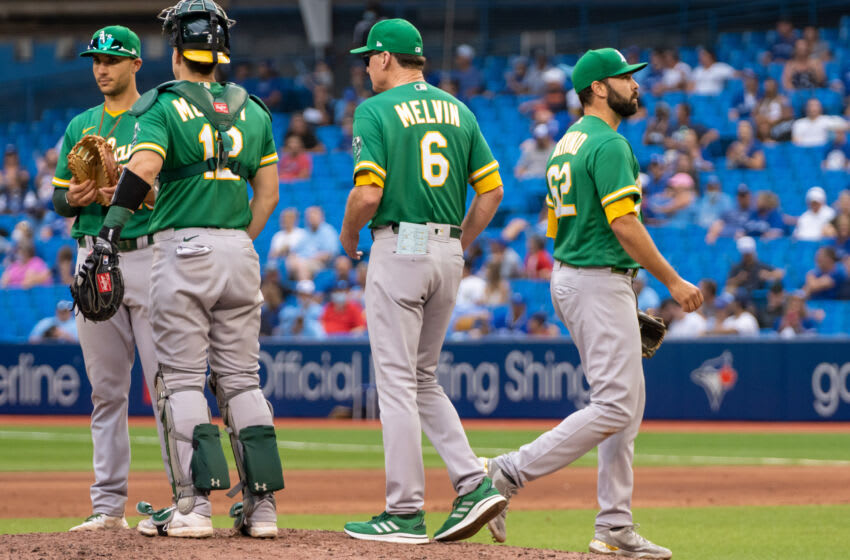 Sep 4, 2021; Toronto, Ontario, CAN; Oakland Athletics relief pitcher Lou Trivino (62) is relieved during the eighth inning against the Toronto Blue Jays at Rogers Centre. Mandatory Credit: Kevin Sousa-USA TODAY Sports