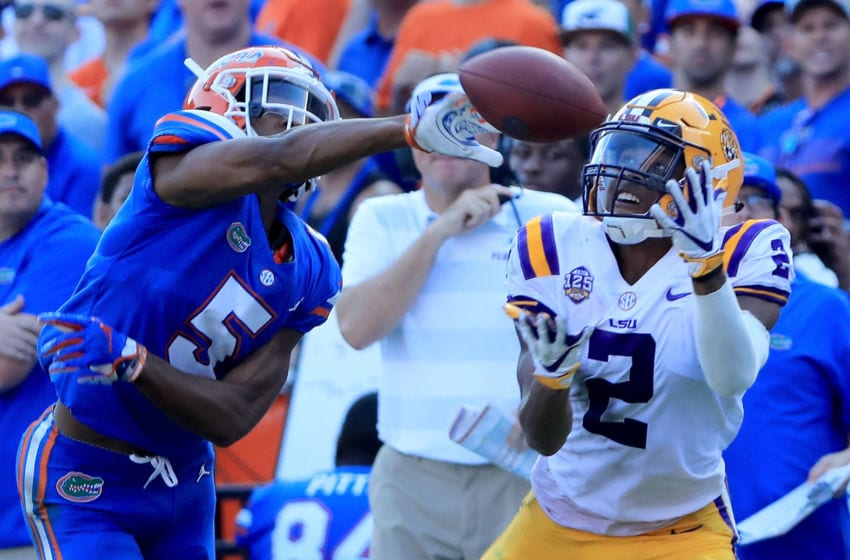GAINESVILLE, FL - OCTOBER 06: Justin Jefferson attempts a reception against CJ Henderson #5 of the Florida Gators during the game at Ben Hill Griffin Stadium on October 6, 2018 in Gainesville, Florida. (Photo by Sam Greenwood/Getty Images)