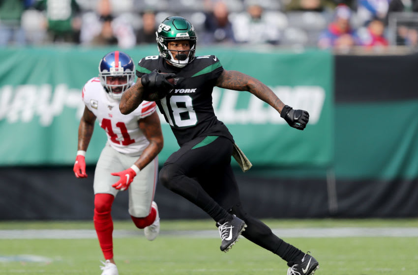 EAST RUTHERFORD, NEW JERSEY - NOVEMBER 10: Demaryius Thomas #18 of the New York Jets carries the ball as Antoine Bethea #41 of the New York Giants defends in the first quarter at MetLife Stadium on November 10, 2019 in East Rutherford, New Jersey. (Photo by Elsa/Getty Images)