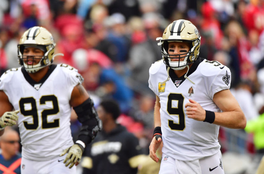 TAMPA, FLORIDA - NOVEMBER 17: Drew Brees #9 of the New Orleans Saints runs back out to the field during the third quarter of a football game against the Tampa Bay Buccaneers at Raymond James Stadium on November 17, 2019 in Tampa, Florida. (Photo by Julio Aguilar/Getty Images)
