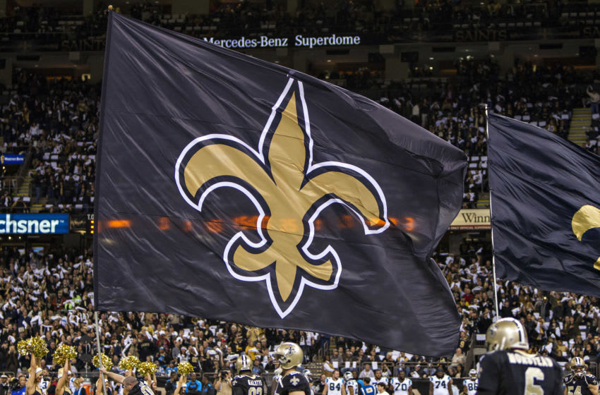 NEW ORLEANS, LA - DECEMBER 8: Flag of the New Orleans Saints is run onto the field before a game against the Carolina Panthers at Mercedes-Benz Superdome on December 8, 2013 in New Orleans, Louisiana. The Saints defeated the Panthers 31-13. (Photo by Wesley Hitt/Getty Images)