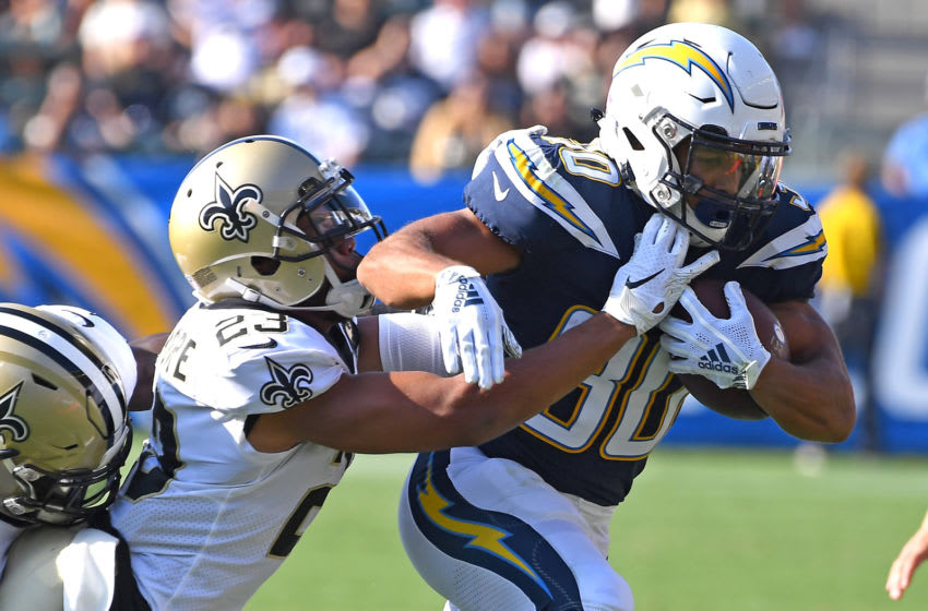 CARSON, CA - AUGUST 25: Marshon Lattimore #23 of the New Orleans Saints forces Austin Ekeler #30 of the Los Angeles Chargers out of bounds after he runs for a first down in the first quarter of the pre-season game at StubHub Center on August 25, 2018 in Carson, California. (Photo by Jayne Kamin-Oncea/Getty Images)