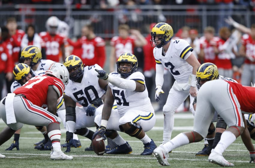 COLUMBUS, OH - NOVEMBER 24: Cesar Ruiz #51 of the Michigan Wolverines gets ready to snap the ball during the game against the Ohio State Buckeyes at Ohio Stadium on November 24, 2018 in Columbus, Ohio. Ohio State won 62-39. (Photo by Joe Robbins/Getty Images)