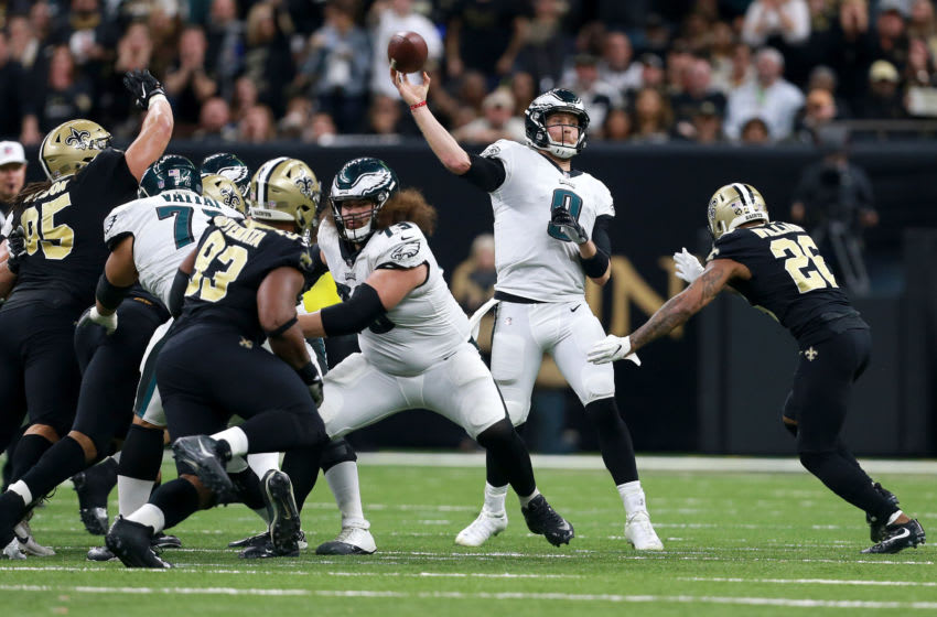 NEW ORLEANS, LOUISIANA - JANUARY 13: Nick Foles #9 of the Philadelphia Eagles drops back to pass during the NFC Divisional Playoff against the Philadelphia Eagles at the Mercedes Benz Superdome on January 13, 2019 in New Orleans, Louisiana. (Photo by Sean Gardner/Getty Images)