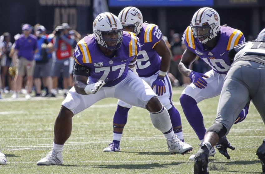 NASHVILLE, TENNESSEE - SEPTEMBER 21: Saahdiq Charles #77 of the LSU Tigers plays against the Vanderbilt Commodores at Vanderbilt Stadium on September 21, 2019 in Nashville, Tennessee. (Photo by Frederick Breedon/Getty Images)