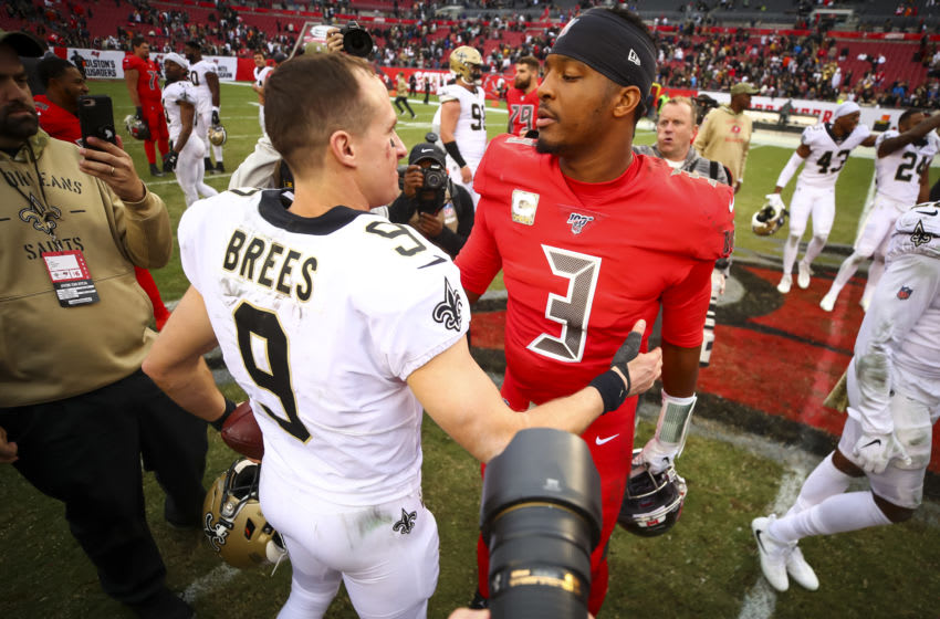 TAMPA, FL - NOVEMBER 17: Jameis Winston #3 of the Tampa Bay Buccaneers shakes hands with Drew Brees #9 of the New Orleans Saints after the game on November 17, 2019 at Raymond James Stadium in Tampa, Florida. (Photo by Will Vragovic/Getty Images)