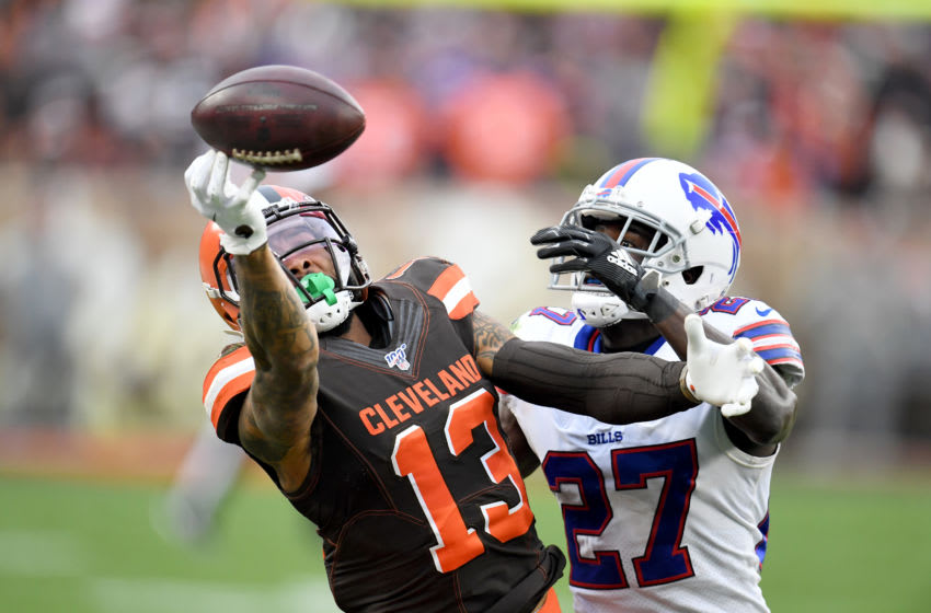CLEVELAND, OHIO - NOVEMBER 10: Wide receiver Odell Beckham #13 of the Cleveland Browns drops a pass while under during pressure from cornerback Tre'Davious White #27 of the Buffalo Bills the second half at FirstEnergy Stadium on November 10, 2019 in Cleveland, Ohio. The Browns defeated the Bills 19-16. (Photo by Jason Miller/Getty Images)