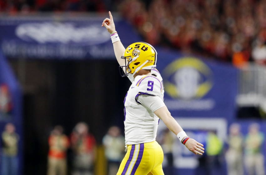 ATLANTA, GEORGIA - DECEMBER 07: Joe Burrow #9 of the LSU Tigers celebrates in the second half against the Georgia Bulldogs during the SEC Championship game at Mercedes-Benz Stadium on December 07, 2019 in Atlanta, Georgia. (Photo by Kevin C. Cox/Getty Images)