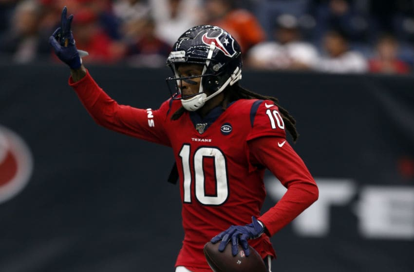 HOUSTON, TEXAS - DECEMBER 08: DeAndre Hopkins #10 of the Houston Texans caches a 43 yard pass for a touchdown during the third quarter against the Denver Broncos at NRG Stadium on December 08, 2019 in Houston, Texas. (Photo by Bob Levey/Getty Images)