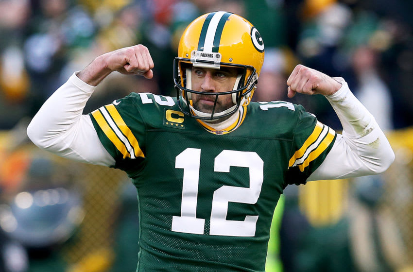GREEN BAY, WISCONSIN - DECEMBER 15: Quarterback Aaron Rodgers #12 of the Green Bay Packers celebrates during the game against the Chicago Bears at Lambeau Field on December 15, 2019 in Green Bay, Wisconsin. (Photo by Dylan Buell/Getty Images)