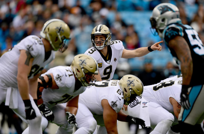 CHARLOTTE, NORTH CAROLINA - DECEMBER 29: Drew Brees #9 of the New Orleans Saints directs players before the snap during the first quarter during their game against the Carolina Panthers at Bank of America Stadium on December 29, 2019 in Charlotte, North Carolina. (Photo by Jacob Kupferman/Getty Images)