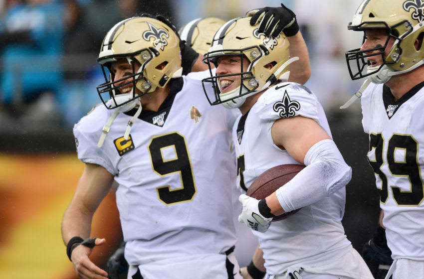 CHARLOTTE, NORTH CAROLINA - DECEMBER 29: Drew Brees #9 and Taysom Hill #7 of the New Orleans Saints celebrate a touchdown pass during the third quarter during their game against the Carolina Panthers at Bank of America Stadium on December 29, 2019 in Charlotte, North Carolina. (Photo by Jacob Kupferman/Getty Images)