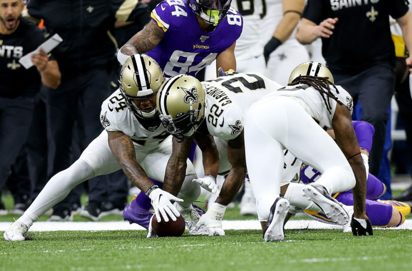 NEW ORLEANS, LOUISIANA - JANUARY 05: Janoris Jenkins #20 of the New Orleans Saints forces a fumble on Adam Thielen #19 of the Minnesota Vikings in the NFC Wild Card Playoff game at Mercedes Benz Superdome on January 05, 2020 in New Orleans, Louisiana. (Photo by Jonathan Bachman/Getty Images)