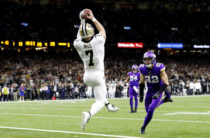 NEW ORLEANS, LOUISIANA - JANUARY 05: Taysom Hill #7 of the New Orleans Saints scores a 20-yard receiving touchdown during the fourth quarter as he is defended by Harrison Smith #22 of the Minnesota Vikings in the NFC Wild Card Playoff game at Mercedes Benz Superdome on January 05, 2020 in New Orleans, Louisiana. (Photo by Kevin C. Cox/Getty Images)