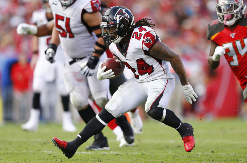 TAMPA, FLORIDA - DECEMBER 29: Devonta Freeman #24 of the Atlanta Falcons runs with the ball against the Tampa Bay Buccaneers during the first half at Raymond James Stadium on December 29, 2019 in Tampa, Florida. (Photo by Michael Reaves/Getty Images)