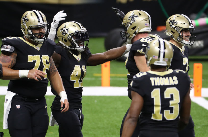 NEW ORLEANS, LOUISIANA - SEPTEMBER 13: Alvin Kamara #41 of the New Orleans Saints celebrates a touchdown against the Tampa Bay Buccaneers during the second quarter at the Mercedes-Benz Superdome on September 13, 2020 in New Orleans, Louisiana. (Photo by Chris Graythen/Getty Images)