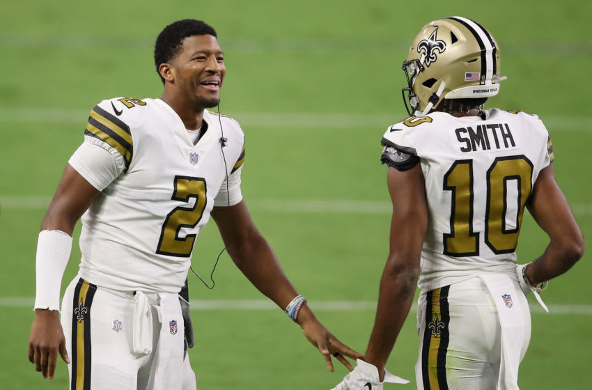 LAS VEGAS, NEVADA - SEPTEMBER 21: Quarterback Jameis Winston #2 of the New Orleans Saints high fives wide receiver Tre'Quan Smith #10 during the NFL game against the Las Vegas Raiders at Allegiant Stadium on September 21, 2020 in Las Vegas, Nevada. The Raiders defeated the Saints 34-24. (Photo by Christian Petersen/Getty Images)