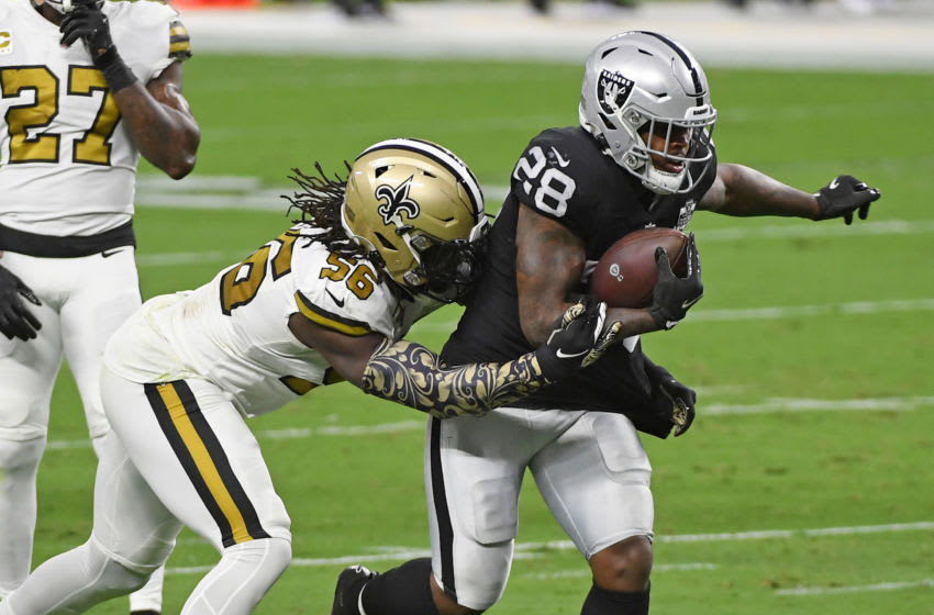 LAS VEGAS, NEVADA - SEPTEMBER 21: Running back Josh Jacobs #28 of the Las Vegas Raiders is tackled by outside linebacker Demario Davis #56 of the New Orleans Saints during the first half of the NFL game at Allegiant Stadium on September 21, 2020 in Las Vegas, Nevada. The Raiders defeated the Saints 34-24. (Photo by Ethan Miller/Getty Images)
