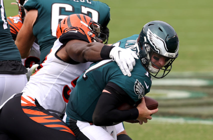 PHILADELPHIA, PENNSYLVANIA - SEPTEMBER 27: Quarterback Carson Wentz #11 of the Philadelphia Eagles is sacked by defensive end Carlos Dunlap #96 of the Cincinnati Bengals in the first half at Lincoln Financial Field on September 27, 2020 in Philadelphia, Pennsylvania. (Photo by Rob Carr/Getty Images)