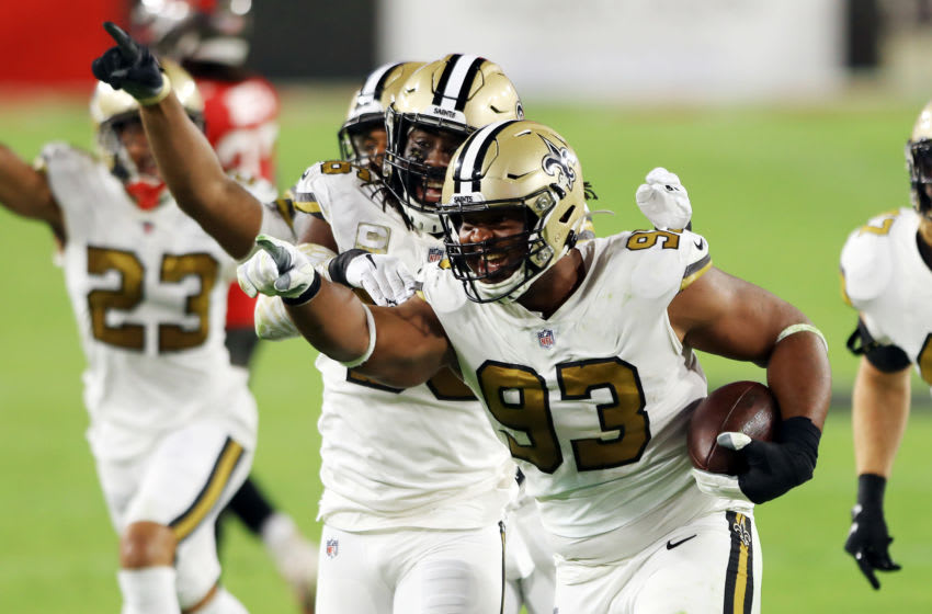 TAMPA, FLORIDA - NOVEMBER 08: David Onyemata #93 of the New Orleans Saints celebrates with teammates after intercepting a pass during the second quarter against the Tampa Bay Buccaneers at Raymond James Stadium on November 08, 2020 in Tampa, Florida. (Photo by Mike Ehrmann/Getty Images)