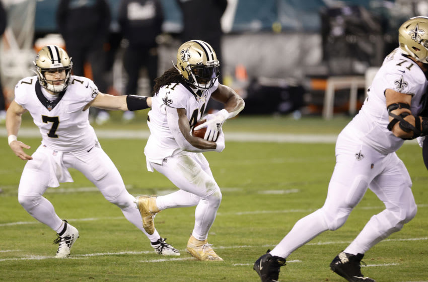 PHILADELPHIA, PENNSYLVANIA - DECEMBER 13: Quarterback Taysom Hill #7 hands the ball off to running back Alvin Kamara #41 of the New Orleans Saints during the first half against the Philadelphia Eagles at Lincoln Financial Field on December 13, 2020 in Philadelphia, Pennsylvania. (Photo by Tim Nwachukwu/Getty Images)