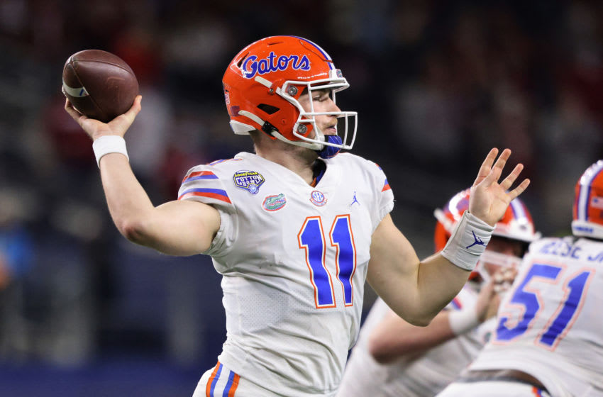 ARLINGTON, TEXAS - DECEMBER 30: Quarterback Kyle Trask #11 of the Florida Gators throws against the Oklahoma Sooners during the second quarter at AT&T Stadium on December 30, 2020 in Arlington, Texas. (Photo by Ronald Martinez/Getty Images)