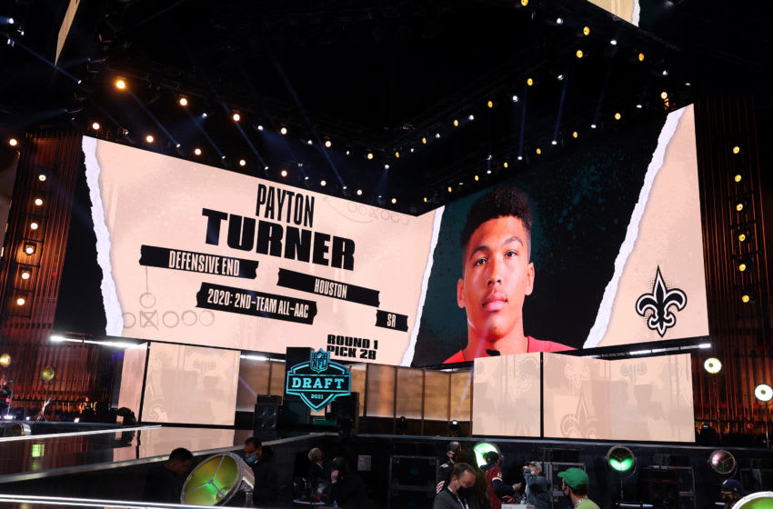 CLEVELAND, OHIO - APRIL 29: NFL Commissioner Roger Goodell announces Payton Turner as the 28th selection by the New Orleans Saints during round one of the 2021 NFL Draft at the Great Lakes Science Center on April 29, 2021 in Cleveland, Ohio. (Photo by Gregory Shamus/Getty Images)