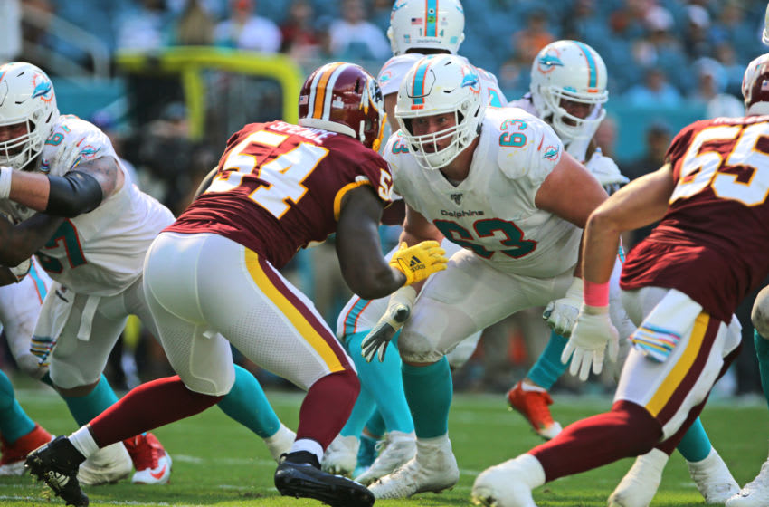 Oct 13, 2019; Miami Gardens, FL, USA; Miami Dolphins offensive guard Michael Deiter (63) plays his position against Washington Redskins defensive end Noah Spence (54) in the fourth quarter of the game at Hard Rock Stadium. Mandatory Credit: Sam Navarro-USA TODAY Sports