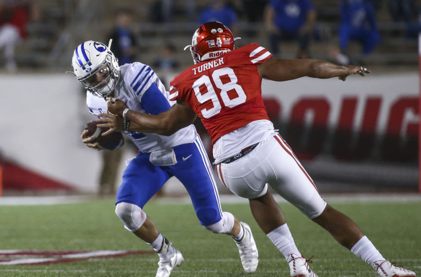 Oct 16, 2020; Houston, Texas, USA; Brigham Young Cougars quarterback Zach Wilson (1) is sacked by Houston Cougars defensive lineman Payton Turner (98) during the second quarter at TDECU Stadium. Mandatory Credit: Troy Taormina-USA TODAY Sports