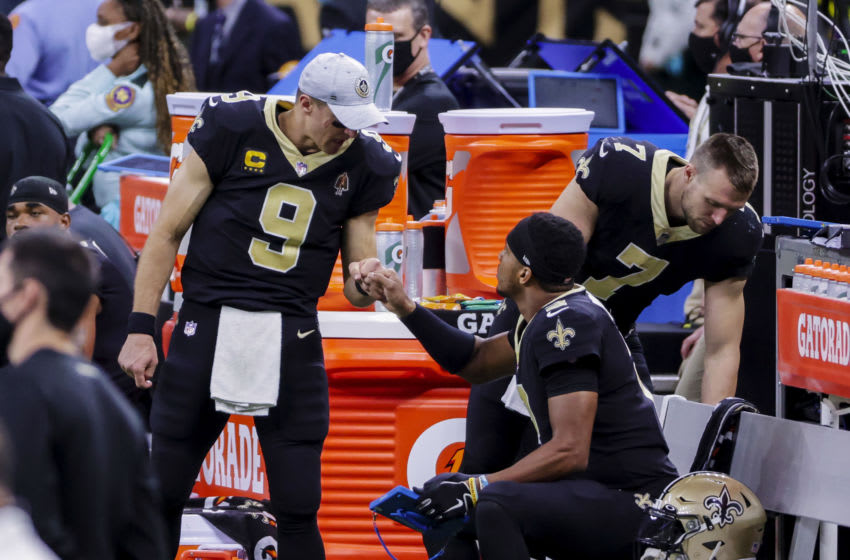 Nov 15, 2020; New Orleans, Louisiana, USA; New Orleans Saints quarterback Drew Brees (9) fist bumps with quarterback Jameis Winston (2) after leaving the game with a injury during the second half against the San Francisco 49ers at the Mercedes-Benz Superdome. Mandatory Credit: Derick E. Hingle-USA TODAY Sports
