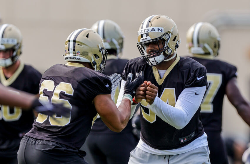 Jul 30, 2021; Metairie, LA, USA; New Orleans Saints defensive end Cameron Jordan (94) and defensive end Kendall Donnerson (66) work on their stretching during a New Orleans Saints training camp session at the New Orleans Saints Training Facility. Mandatory Credit: Stephen Lew-USA TODAY Sports