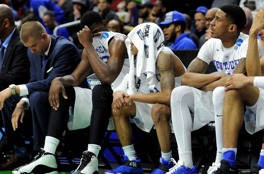 Mar 19, 2016; Des Moines, IA, USA; Kentucky Wildcats guard Tyler Ulis (3) and Kentucky Wildcats forward Alex Poythress (22) reacts on the bench in the second half against the Indiana Hoosiers during the second round of the 2016 NCAA Tournament at Wells Fargo Arena. Mandatory Credit: Steven Branscombe-USA TODAY Sports