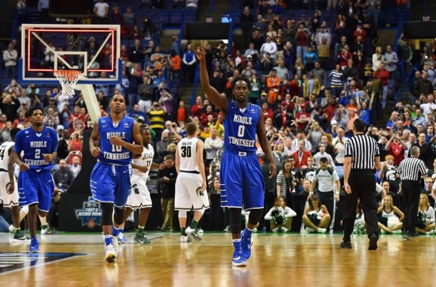 Mar 18, 2016; St. Louis, MO, USA; Middle Tennessee Blue Raiders players celebrate after the game against the against the Michigan State Spartans in the first round in the 2016 NCAA Tournament at Scottrade Center. Middle Tennessee State won 90-81. Mandatory Credit: Jasen Vinlove-USA TODAY Sports
