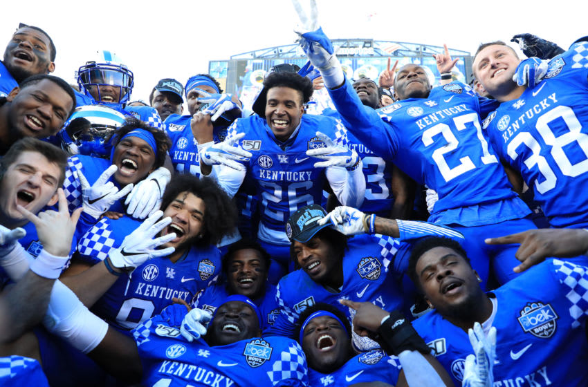 CHARLOTTE, NORTH CAROLINA - DECEMBER 31: The Kentucky Wildcats celebrate after defeating the Virginia Tech Hokies 37-30 in the Belk Bowl at Bank of America Stadium on December 31, 2019 in Charlotte, North Carolina. (Photo by Streeter Lecka/Getty Images)