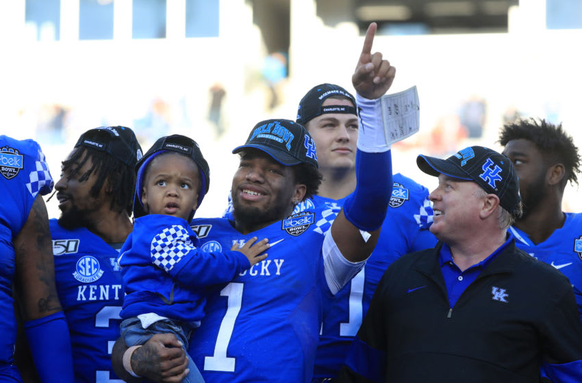 CHARLOTTE, NORTH CAROLINA - DECEMBER 31: Lynn Bowden Jr. #1 of the Kentucky Wildcats celebrates with head coach Mark Stoops after defeating the Virginia Tech Hokies 37-30 in the Belk Bowl at Bank of America Stadium on December 31, 2019 in Charlotte, North Carolina. (Photo by Streeter Lecka/Getty Images)